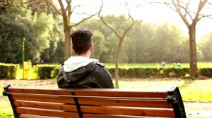 stock-footage-sad-boy-at-park